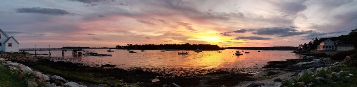 Panoramic view of orange sunset at Ocean Point Inn in Boothbay Harbor