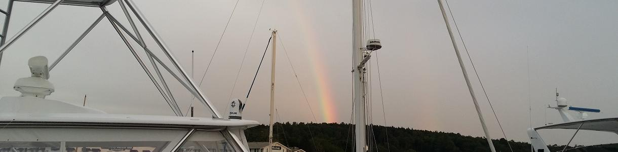 Image of rainbow over boats docked in the harbor, Boothbay Harbor, Maine
