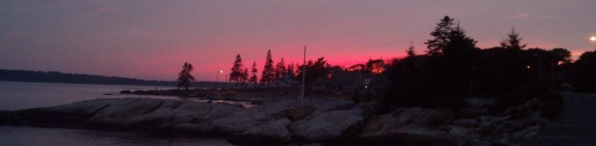 Image of winter sunset over the water at Spruce Point, Boothbay, Maine.